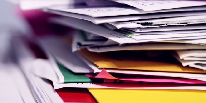 stack of colorful papers and folders