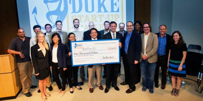 team members holding giant check at the 2013 Duke Start-up Challenge