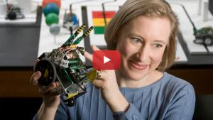 Faculty member Lisa Huettel with robot