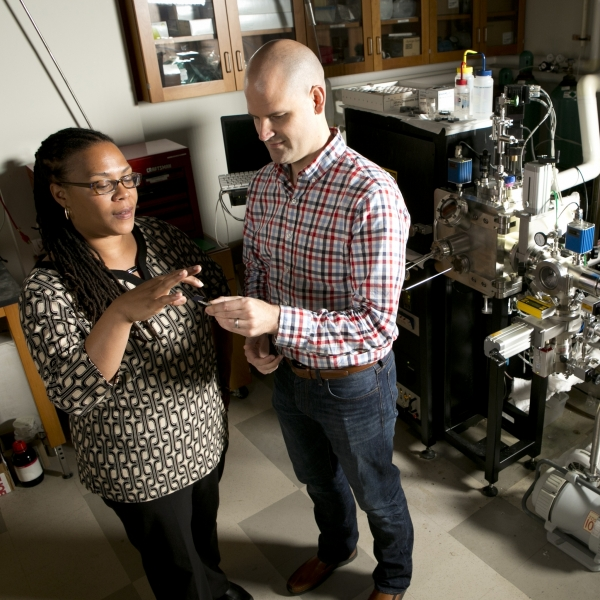 Adrienne Stiff-Roberts works with a PhD student in her lab