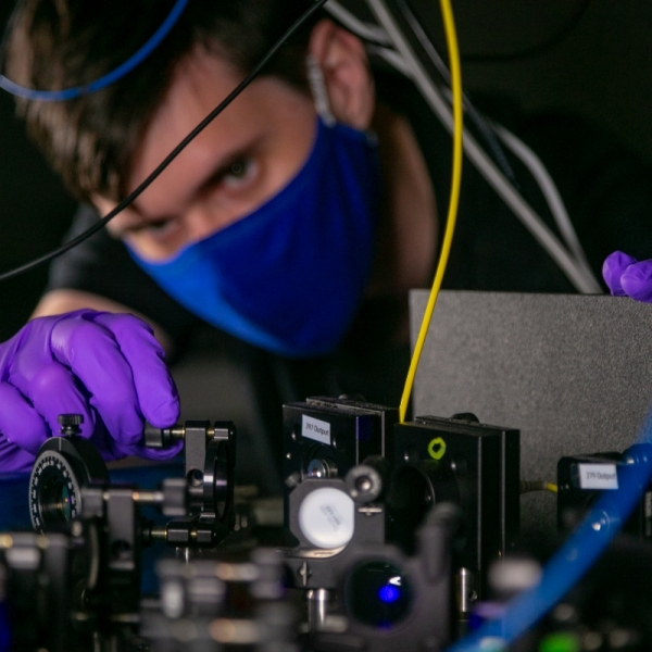 Eric Pretzsch works on a quantum computer setup in the Brown Lab