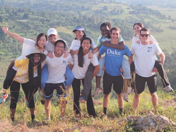 Duke engineering students pose with project leaders in the Ugandan countryside.