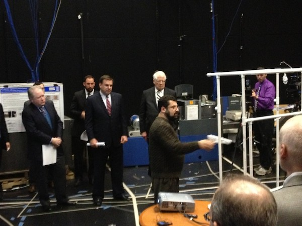 Reps. George Holding (R-NC), Richard Hudson (R-NC), and David Price (D-NC) observe Duke researcher Daniel Marks demonstrate a non-mechanical mmw personnel scanner, part of the MetaImager project.