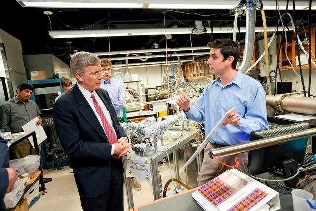 Dan Poneman hears about several projects using an atomic layer deposition system while visiting the laboratory of ECE professor Jeff Glass.