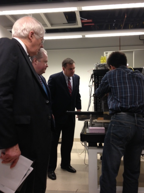 Reps. Price, Holding, and Hudson observe a demonstration of the x-ray scatter technology being developed at Duke University.